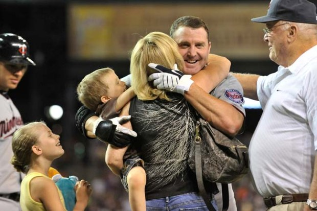 Jim Thome hugs his wife, Andrea, and children while getting a pat on the back from his dad, Chuck, after hitting his 600th career home run in Detroit in 2011.