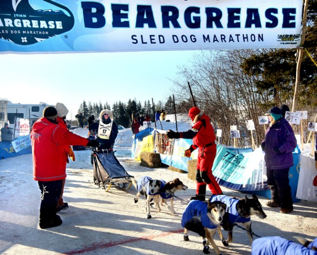 Ryan Anderson of Ray, Minn., comes under the finish banner as he wins the John Beargrease Sled Dog Marathon on Wednesday morning, Feb. 2, 2011, in Duluth, Minn. (AP Photo/Duluth News Tribune, Bob King)