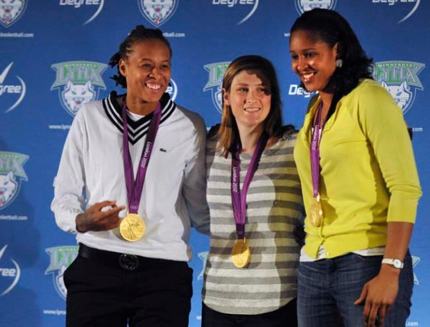 Recently returned from the London Olympics, Minnesota Lynx players and gold medal winners, from left; Seimone Agustus, Lindsay Whalen and Maya Moore appeared at a press conference at Target Center, Wednesday, August 15, 2012 in Minneapolis. (Pioneer Press: Chris Polydoroff)