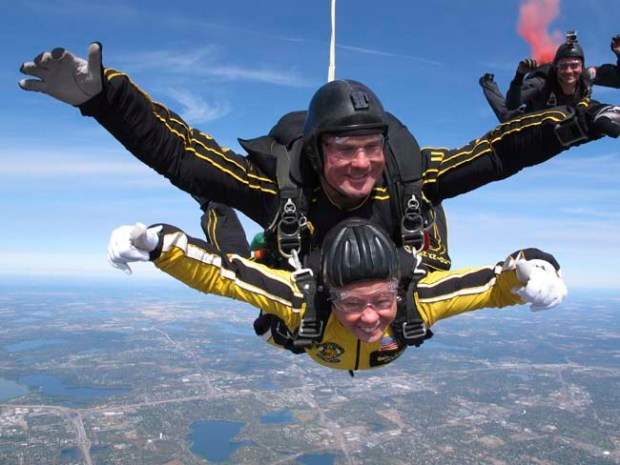 "Lieutenant Governor Yvonne Prettner Solon, bottom, skydives with tandem instructor Sergent First Class Aaron Figel, of the U.S. Army Parachute Team, nicknamed the ""Golden Knights,"" over St. Paul on Tuesday, Sept. 25, 2012. Lt. Governor Prettner Solon jumped from an altitude of 12,500 feet and fell at a rate of 120 miles per hour before making a safe landing on the Minnesota State Capitol grounds. (Courtesy to Pioneer Press)"