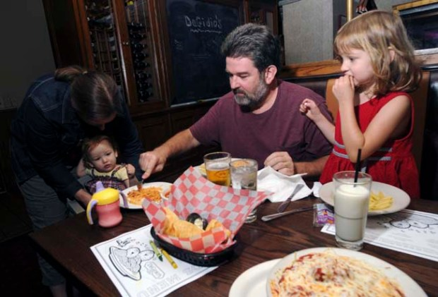 Julie Salter puts Emily, 17 months old, into her highchair, as David and Megan Salter get ready to eat their pasta at DeGidios, 425 West Seventh Street, St. Paul, on Tuesday, September 25, 2012. ( Pioneer Press: Scott Takushi)