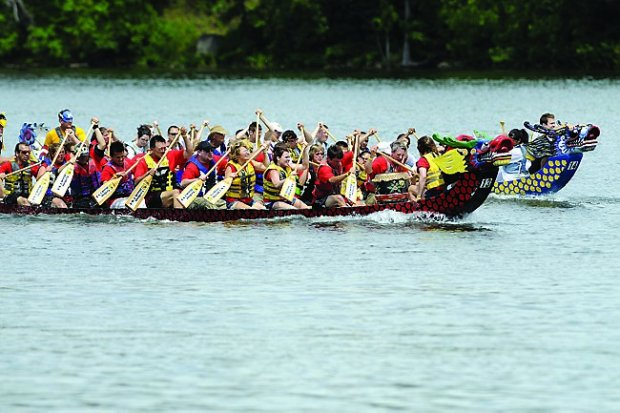 The Cub Piranahas, (foreground), battled with the Best Buy Blue Dragons during an afternoon of dragon boat races , during the Dragon Festival at St. Paul's Lake Phalen, on Sunday, July 11, 2010. (Pioneer Press: Scott Takushi)