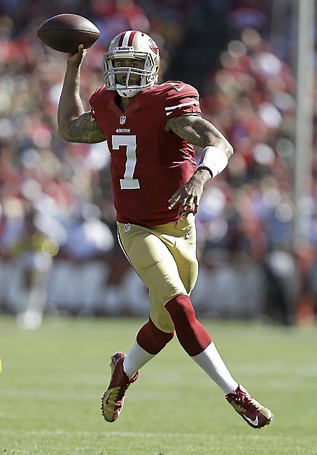 San Francisco quarterback Colin Kaepernick (7) passes against the Green Bay Packers during the third quarter of their game in San Francisco, Sunday, Sept. 8, 2013. (AP Photo/Marcio Jose Sanchez)