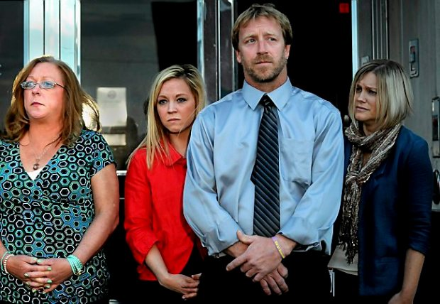 Kira Steger's mother, Marcie Steger, sister Keri Anne Steger, father Jay Steger and victim's advocate Jen Mallenger listen to their lawyer speak to the press after the verdict was read convicting Jeffery Trevino of one count of second-degree murder of his wife, Kira Steger Wednesday October 2, 2013 at Ramsey County Courthouse, St. Paul. (Pioneer Press: Jean Pieri)