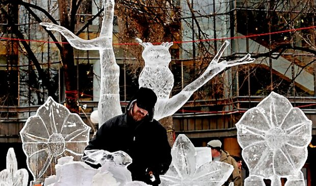"Derek Pasley, St. Paul, carves a rabbit on a sculpture called ""Icechanted Forest"" at the St. Paul Winter Carnival multi-block ice carving competition Friday January 24, 2014 in Rice Park in St. Paul. ""It's very fun,"" said the first-year ice carver. ""I do a lot of wood carving and I've carved marble. It's kind of a combination of the two,"" he said. (Pioneer Press: Jean Pieri)"