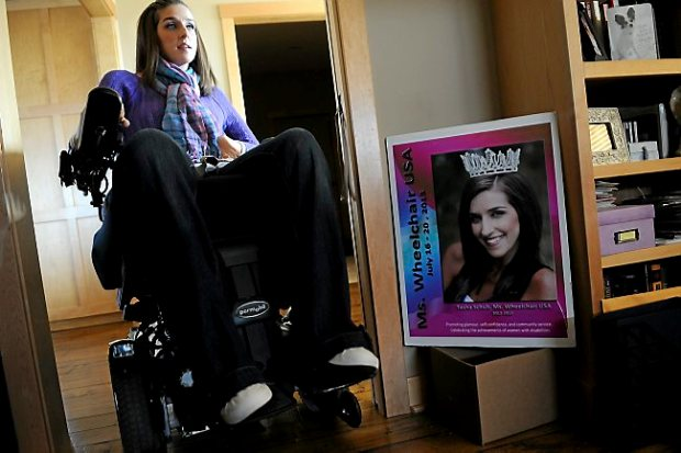 Motivational speaker, singer and author Tasha Schuh rolls into an office at her home in Ellsworth, Wis., on Wednesday April 9, 2014. She was crowned Miss Wheelchair USA in 2012. (Pioneer Press: Jean Pieri)