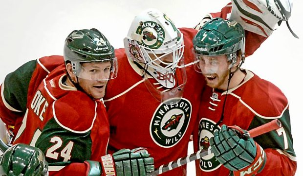 Minnesota goalie Ilya Bryzgalov celebrates with left wing Matt Cooke, left, and defenseman Jonathon Blum after the Wild's 4-3 shootout win over the Bruins at Xcel Energy Center in St. Paul on Wednesday, April 8, 2014. (Pioneer Press: John Autey)