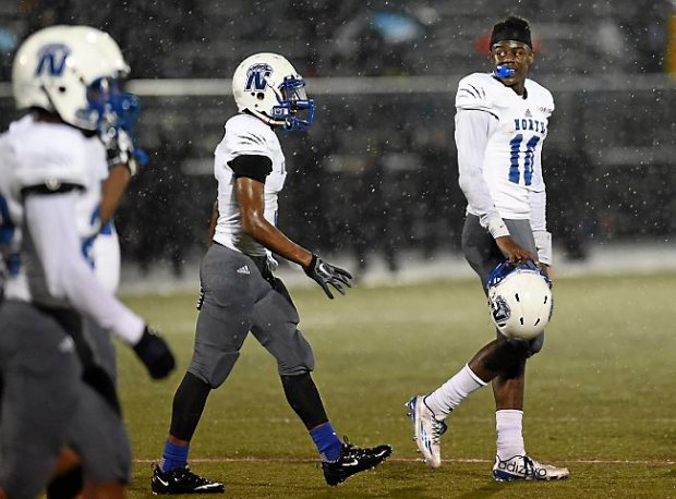 Minneapolis North senior quarterback Tyler Johnson walks off the field after losing his helmet in the second quarter of a game at Central High School in St. Paul on Friday, Sept. 18, 2015. (Pioneer Press: Holly Peterson)