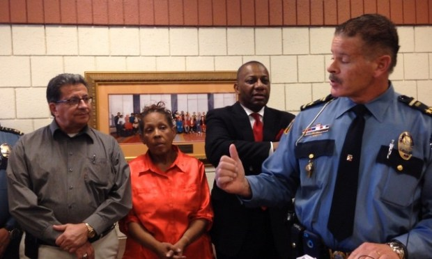 St. Paul Police Chief Thomas Smith, right, gestures to community leaders Don Luna, Dianne Binns and Tyrone Terrill during a news conference Wednesday, April 29, 2015, at the Hallie Q. Brown Community Center in St. Paul. Smith and other participants urged parents of wayward teens to seek help to put their children back on the path for success. (Pioneer Press: Jaime DeLage)