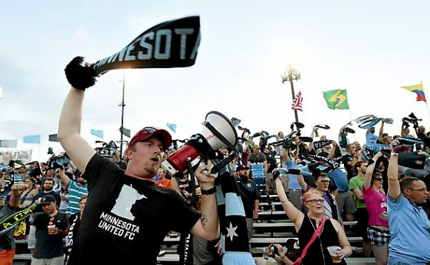"""Jason Rynders leads the 'The Dark Clouds"""" fan section in support of Minnesota United as they play Jacksonville Armada FC during the second half of a soccer match at the National Sports Center in Blaine on Wednesday, July 15, 2015. Minnesota beat Jacksonville, 4-0. (Pioneer Press: John Autey)"""