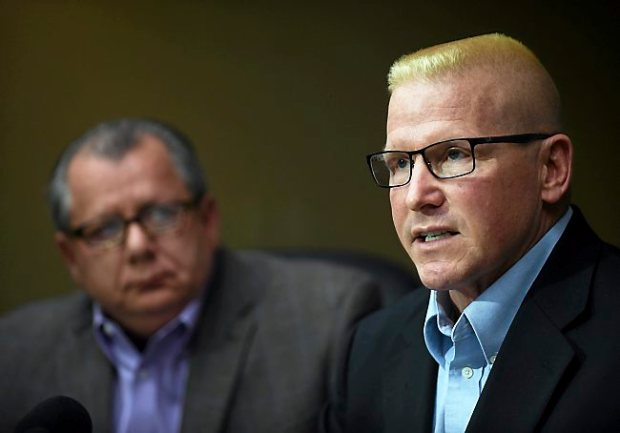 St. Paul Central High School teacher John Ekblad, right, speaks about his plans to sue St. Paul Public Schools for failing to maintain a safe work environment. At left is his attorney, Philip G. Villaume. Ekblad was hurt while intervening in a Dec. 4 lunchroom melee at St. Paul Central. (Pioneer Press: Scott Takushi)