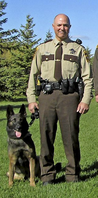 Brett Arthur Berry and his police dog partner. (2014 image via Ramsey County sheriff's office)