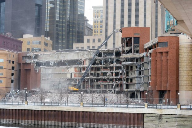 Construction crews tear into the former Ramsey County Jail building facing the Mississippi River beneath downtown St. Paul, on Jan. 26, 2016. (Pioneer Press: Scott Takushi)