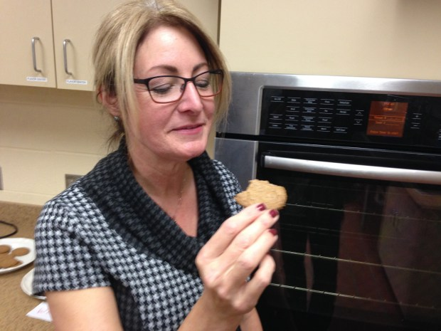 "Food scientist Tonya Schoenfuss tastes a sugar cookie made with kernza flour instead of wheat flour Oct. 15, 2015, at the University of Minnesota St. Paul campus. ""I get like a molasses flavor, almost like brown sugar,"" she said. (Pioneer Press: Jaime DeLage)"