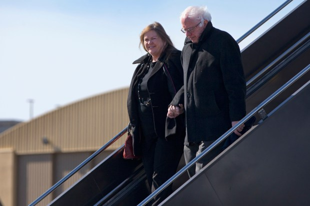 Democratic presidential candidate, Sen. Bernie Sanders, I-Vt. and his wife Jane Sanders, hold hands as they arrive in Minneapolis, Minn., Monday, Feb. 29, 2016, the day before Super Tuesday. (AP Photo/Jacquelyn Martin)