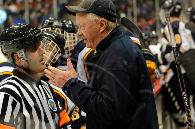 Hermantown head coach Bruce Plante talks to a referee during a Class A semifinal game against New Prague in the State Boys Hockey Tournament at Xcel Energy Center in St. Paul on Friday, March 7, 2014. Hermantown won 4-2, earning its fifth consecutive trip the Class A title game. (Pioneer Press: Jean Pieri)