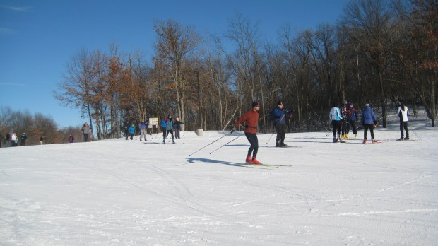 LAKE ELMO PARK RESERVE. This park in Lake Elmo features 10.8 miles of classic and skate ski trails that travel over gentile hills and loop around lakes. Skiers may find this a good option for evening skiing, as 5.4 miles of trails, which begin at the Park's Nordic Center, are lit and open until 9:45 p.m. Vehicles entering the reserve require a Washington County vehicle permit ($5 daily; $25 season). Equipment rental is not available. (Photo courtesy of Washington County Parks)