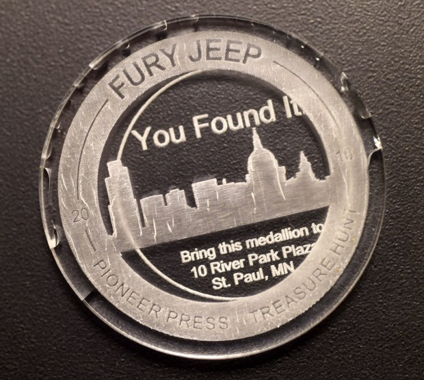 The Pioneer Press Treasure Hunt medallion was found in Bald Eagle-Otter Lake Regional Park by Heather Vocke, Christopher Jozwiak, and Phillip Kitzer, all of Minneapolis, late Wednesday, Feb. 3, 2016. (Pioneer Press: Scott Takushi)