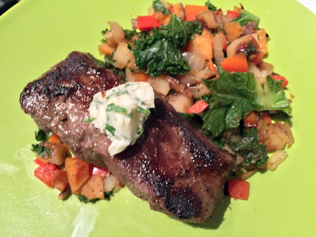 Flat-iron steak with garlic-potato-red pepper hash and fine herbes butter from Home Chef. (Pioneer Press: Nancy Ngo)
