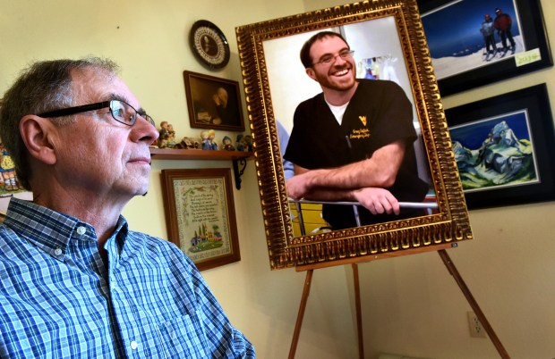 Dan Seftick sits by a photo of his son Greg Seftick in his Afton home on April 6, 2016. Greg was killed by an avalanche in the Grand Teton mountains five years before. (Pioneer Press: Jean Pieri)