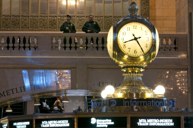 A pair of Metro-North Railroad Police officers patrol in New York's Grand Central Terminal, Tuesday, March 22, 2016. Authorities are increasing security throughout New York City following explosions at the airport and subway system in the Belgian capital of Brussels. (AP Photo/Richard Drew)