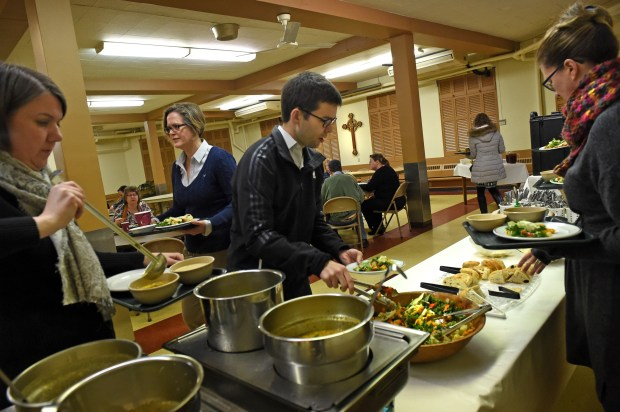 Diners go through the food line at Central Presbyterian Church in downtown St. Paul Wednesday, March 9, 2016. For 25 years Chef Barb Westman works with staff and volunteers to prepare the Wednesday lunch at Central Presbyterian Church. (Pioneer Press: Jean Pieri)