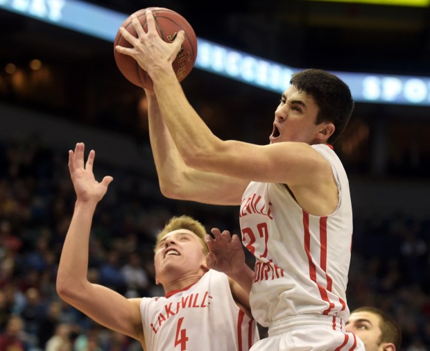Lakeville North's Drew Stewart grabs a rebound before teammate Nick Fossey can get to it during the second half of the Panthers 60-49 win over the Maple Grove Crimson 60-49 during a quarterfinal game of the Class 4A State Boys Basketball Tournament at Target Center in Minneapolis on Wednesday, March 9, 2016. (Pioneer Press: Scott Takushi)