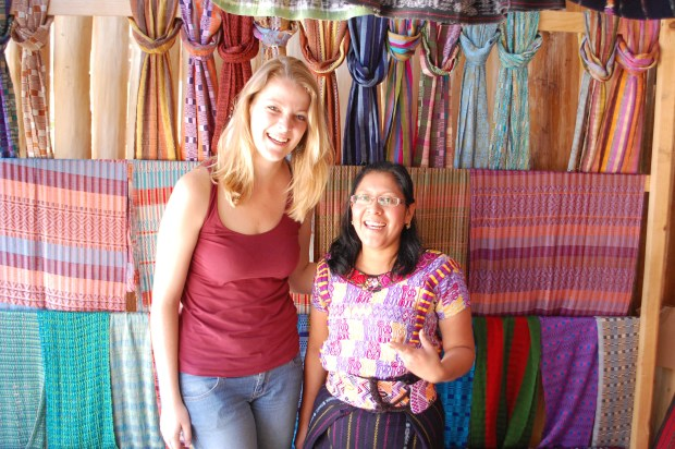 Fair Anita owner Joy O'Brien visits with a woman in a marketplace in San Juan, Guatemala. (Courtesy of Brian Bell)