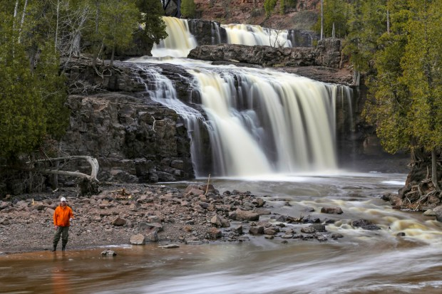 A man fishes near the falls at Gooseberry Falls State Park on May 16, 2014. (Pioneer Press: Andy Rathbun)