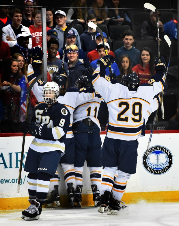 Hermantown celebrates their first goal in front of St. Paul Academy and Summit School fans in the Class A quarterfinal of the Minnesota State High School League Boys' State Tournament at Xcel Energy Center in St. Paul on Friday, March 4, 2016.  (Pioneer Press: Jean Pieri)
