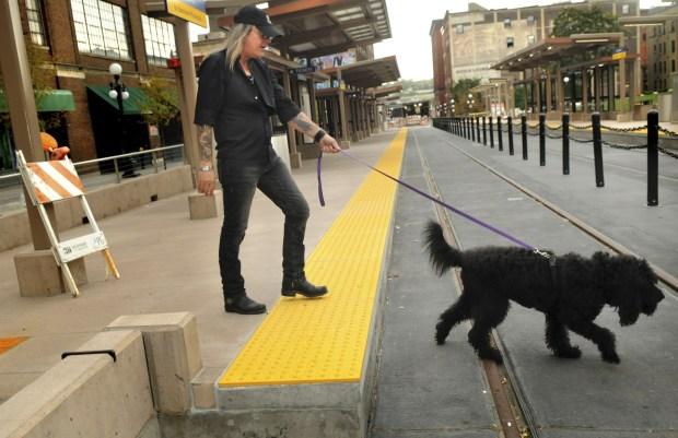 Downtown St. Paul resident J.D. Gassman walks his dog, Maggie, on Fourth Street. (Pioneer Press file: Jean Pieri)