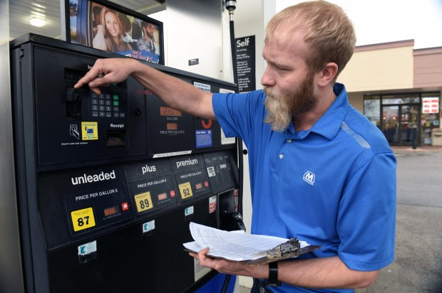 Store manager Matt Klinkhammer checks the gas pumps at New-Mart Marathon in Eagan in March 2016 to make sure would-be thieves have not installed electronic devices that steal data from customers' credit cards. (Scott Takushi / Pioneer Press)