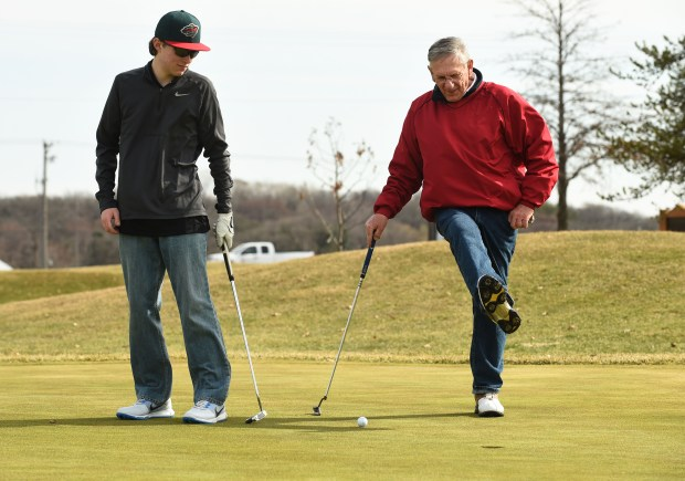 Chuck Starzecki, right, uses body english to guide the ball to the cup, at the River Oaks Golf Course in Cottage Grove, while golfing with his grandson Brendan Starzecki, on Tuesday, March 29, 2016. (Pioneer Press: Scott Takushi)