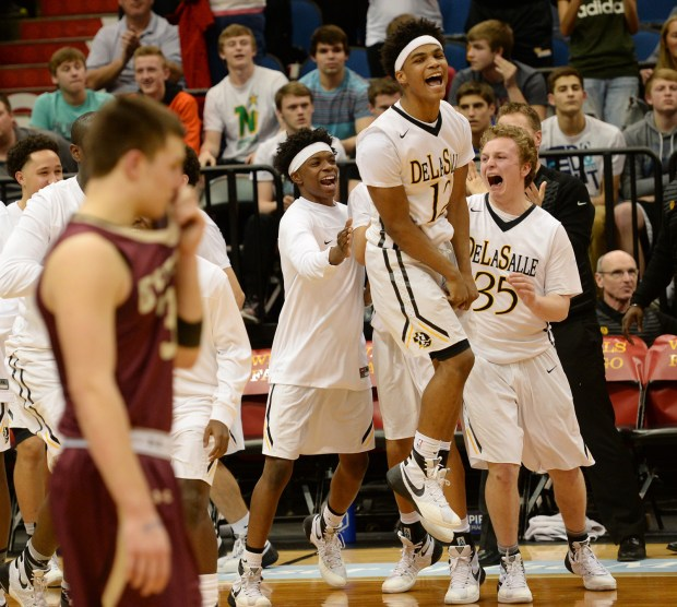 DeLaSalle Sage Booker leaps for joy as he celebrates DeLaSalle victory over Fergus Falls to claim the Islanders 5th consecutive 3A State Championship in the State Boys' Basketball Tournament at Target Center in Minneapolis on Saturday, March 12, 2016. (Pioneer Press: John Autey)