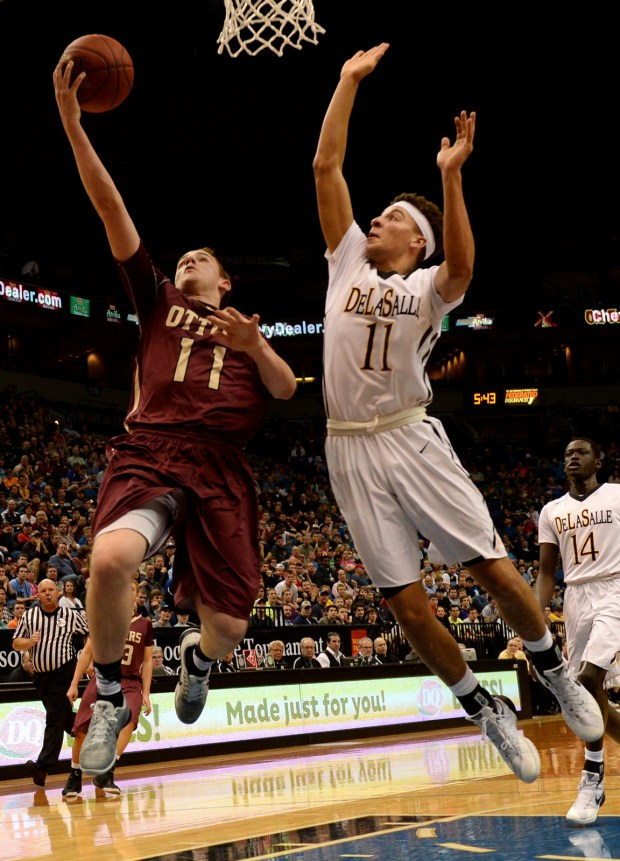 Fergus Falls Harrison Christensen attempts a lay-up against DeLaSalle Gabe Kalscheur during the first half of the Class 2A championship game of the State Boys' Basketball Tournament at Target Center in Minneapolis on Saturday, March 12, 2016. (Pioneer Press: John Autey)