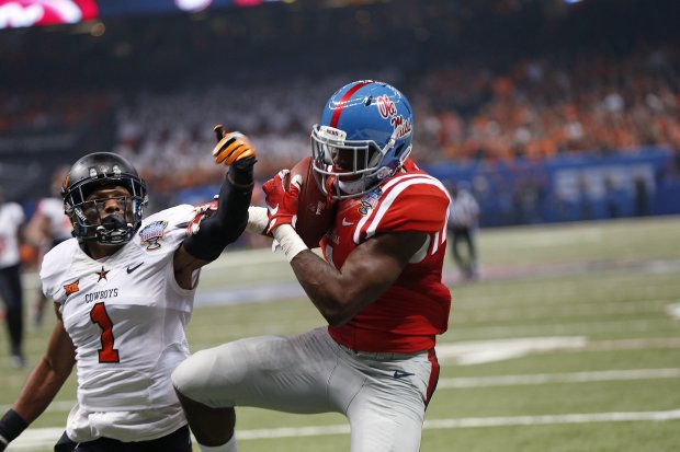 Mississippi wide receiver Laquon Treadwell (1) pulls in a touchdown reception in front of Oklahoma State cornerback Kevin Peterson (1) in the first half of the Sugar Bowl in New Orleans, Friday, Jan. 1, 2016. (AP Photo/Bill Feig)