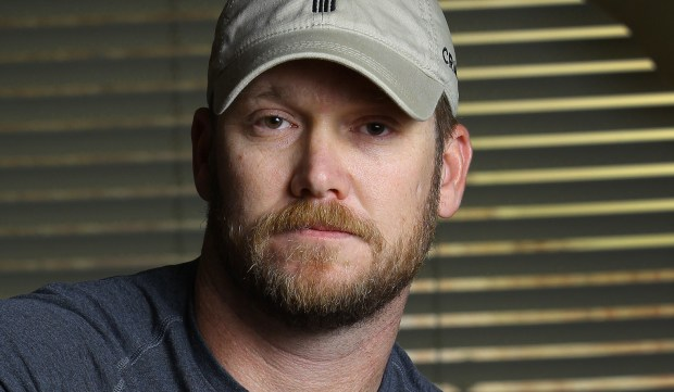 """The late former Navy SEAL Chris Kyle was born on this day in 1974. Actor Bradley Cooper portrayed him in """"American Sniper,"""" the movie based on his autobiography. The retired Navy SEAL was killed in 2013 by a war veteran he was trying to help. And later, former Minnesota Gov. Jesse Ventura won $1.8 million in a defamation lawsuit against his estate, for Kyle's claim in """"American Sniper"""" that he punched out a man, whom he later identified as Ventura, at a California bar in 2006 for allegedly saying the SEALs """"deserve to lose a few"""" in Iraq. Ventura said it never happened. (AP Photo/The Fort Worth Star-Telegram, Paul Moseley, File)"""