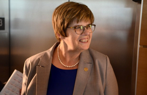 Ginny Arthur, who was named president of Metropolitan State University on Wednesday, steps out of an elevator in the Senate Office Building in St. Paul on April 20, 2016. Arthur, the school's executive vice president and provost, will take over as the president July 1. (Pioneer Press: David Montgomery)