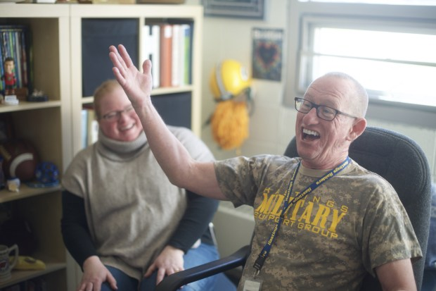 Hastings Middle School counselor Rick Wheeler talks with his fellow counselors Charlie Black (not pictured) and Ellen Rademacher, left, in his office on April 1, 2016, about the joys and difficulties of counseling almost 500 students a year. Some lawmakers hope additional funding this year could help pay for more school support staff statewide and reduce Minnesota's high ratio of counselors to students. (AP Photo/Kevin Burbach)