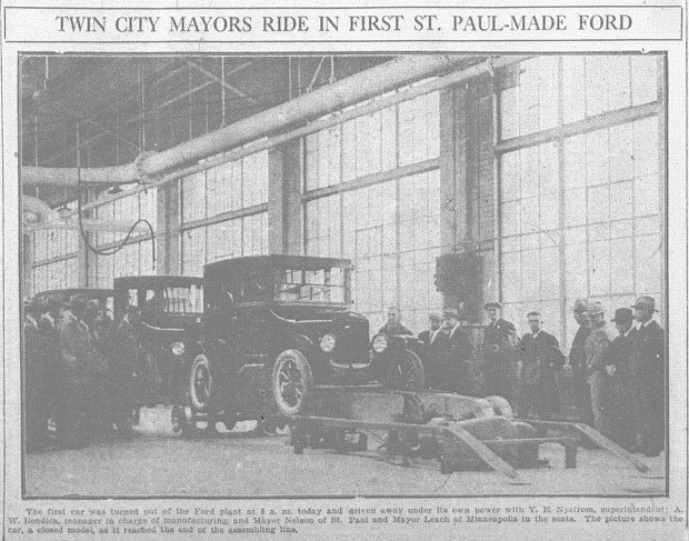 The first automobile assembled in St. Paul rolls off the line at the Ford plant in Highland Park.