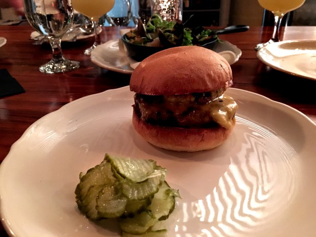 Chef Adam Eaton's buttery burger at Saint Dinette in St. Paul. (Pioneer Press: Jessica Fleming)