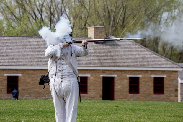 Fort Snelling interpreter Peter Edwards fires a musket Wednesday, April 20, 2016, while talking with students from Hastings Middle School. (Pioneer Press: Andy Rathbun)