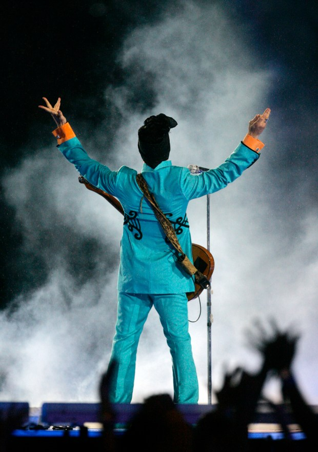 Prince performs during the halftime show at Super Bowl XLI at Dolphin Stadium in Miami on Feb. 4, 2007. (AP Photo/Chris Carlson)