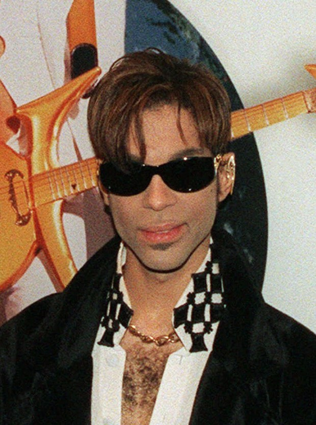 FILE--The artist formerly known as Prince is shown in this July 22, 1997, file photo. It turns out, the artist formerly known as Prince doesn't like to be called that. The singer tells Time magazine in its current editions that his name is simply the unpronounceable symbol that appears on his album covers. (AP Photo/Adam Nadel, File)
