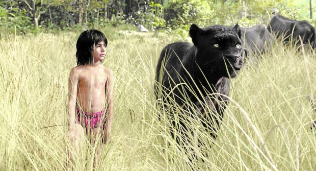 "Neel Sethi as Mowgli and Bagheera, voiced by Ben Kingsley in ""The Jungle Book."""