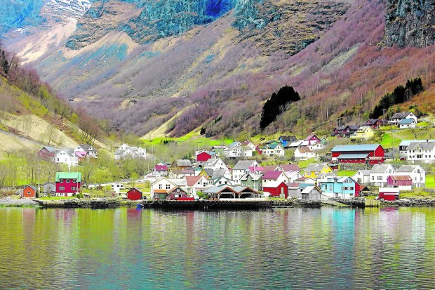 Cruising the Norwegian fjords from Flam to Gudvangen, you'll spy colorful little villages sprawled along the bank. (Amy Laughinghouse)