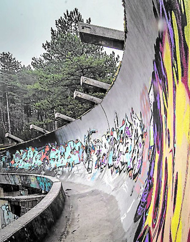 Graffiti blankets the abandoned 1987 Olympic bobsled track. (Elliot Weir)
