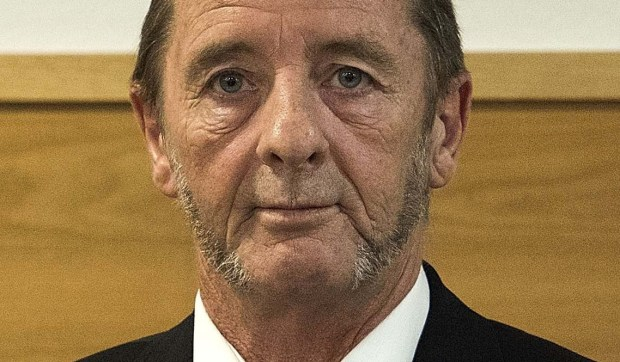 Former AC/DC drummer Phil Rudd is 62. He can't tour with the band on account of his trying to hire a hitman to kill someone, and for having methamphetamine. He's shown in a New Zealand court in April 2015. (Getty Images: Marty Melville)