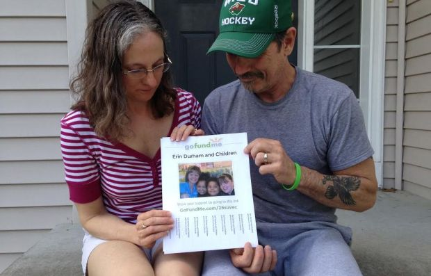 Beth and Tim Moore, aunt and uncle of Erin Durham, show the gofundme.com page established to help Durham's mother care for her children. (Pioneer Press: Molly Guthrey)
