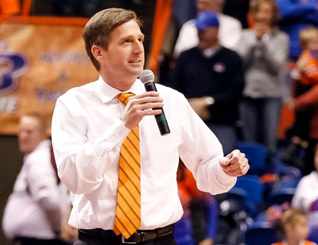 In this Dec. 14, 2013, file photo, Boise State athletics director Mark Coyle talks to the crowd during halftime of an NCAA college basketball game in Boise, Idaho. Coyle, currently Syracuse's athletic director, is the finalist for the Gophers' athletic director job University of Minnesota President Eric Kaler announced May 11, 2016. Coyle, 47, took over the Syracuse position last June. He was also Boise State's AD from 2011-2015 and a deputy AD at Kentucky before that. (AP Photo/Otto Kitsinger)